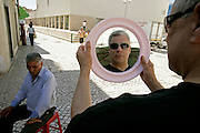 Trumpet player Herb Robertson choosing sunglasses in downtown Coimbra where many gipsy sellers commerciate counterfeit goods.