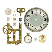 Clock parts, clock faces, and watch mechanisms on a white background