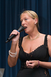Woman singing into microphone,