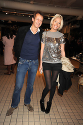 The HON.SOPHIA HESKETH and ROBIE UNIACKE at a party to celebrate the 2nd issue of Distill Magazine held at The Shop at Bluebrid, Kings Road, London on 1st December 2008.