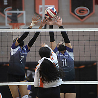 Miyamura's Tanaysha Walker (2) and Darian Yazzie (11) defend the net against a spike by Gallup's MiKaela McCraith (13) at Gallup High School Thursday night in Gallup. The Gallup Bengals had a 22-25, 25-23, 25-22, 25-14 victory over the Miyamura Patriots.