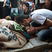 August 09, 2012 - Marea, Aleppo, Syria: Local men mourn the death of Housin Al Ali and Omam Kassam, two Free Syria Army fighters killed in combat in Alepo's Salehedine neighborhood...The Syrian army and the FSA have in the past week exchanged heavy fire in a battle for the control of Syria's economic capital, Aleppo. (Paulo Nunes dos Santos/Polaris)