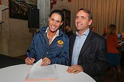 "Michele Georg and Peter Bollen signing a sponsor contract with Cavalor<br /> Pressconference ""Vlaanderens Kerstjumping"" - Mechelen 2012<br /> © Dirk Caremans"