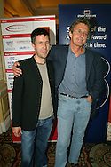 Lead actor Paddy Considine (left) and director Pawel Pawlikowski celebrate winning the prestigious Michael Powell Award for Best New British Feature Film with their film 'My Summer Of Love' at the 2004 Edinburgh International Film Festival which ends today.