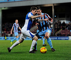 Bristol Rovers' Steven Gillespie runs at Scunthorpe United's Niall Canavan  - Photo mandatory by-line: Dougie Allward/JMP - Tel: Mobile: 07966 386802 25/02/2014 - SPORT - FOOTBALL - Scunthorpe - Glanford Park - Scunthorpe United v Bristol Rovers - Sky Bet League Two