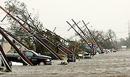 Power poles are pushed over in a flooded street after Hurricane Katrina struck Gretna, Louisiana August 29, 2005. Hurricane Katrina ripped into the U.S. Gulf Coast on Monday, battering the historic jazz city New Orleans, swamping resort towns and lowlands with a crushing surge of seawater and stranding people on rooftops. REUTERS/Rick Wilking