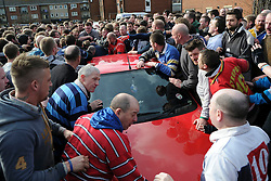 © London News Pictures. 04/03/2014. Ashbourne, UK. A car is surrounded by players. Two teams, the Up'Ards and the Down'Ards, fight for the ball during the first day of the Royal Shrovetide Football match in Ashbourne, Derbyshire. For two days, over Shrove Tuesday and Ash Wednesday, hundreds of participants battle it out in a 'no rules' game dating back to the 17th Century where the aim is to get a ball into one of two goals that are positioned three miles apart at either end of Ashboune. Photo credit: Ben Cawthra/LNP
