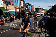Street scene with fixed wheel bicycles on a busy summer day at Camden Market, North London. Camden Lock is a crowded hang out for young Londoners and tourists.