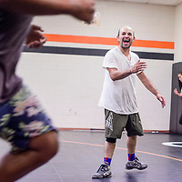 New Bengals wrestling coach Lenny Baca shouts encouragement to his wrestlers during their workout at Gallup High School Thursday.