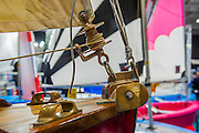 Old and the new... a dinghy designed by Francois Vivier with bronze fittings, in fornt of modern fiberglas boats.  The CWM FX London Boat Show, taking place 09-18 January 2015 at the ExCel Centre, Docklands, London. 09 Jan 2015.