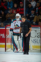 KELOWNA, CANADA - JANUARY 3: Kelowna Rockets' athletic therapist, Scott Hoyer stands on the ice with James Porter #1 against the Tri-City Americans on January 3, 2017 at Prospera Place in Kelowna, British Columbia, Canada.  (Photo by Marissa Baecker/Shoot the Breeze)  *** Local Caption ***