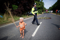 *permission given by parents to photograph child* © London News Pictures.  27/07/2013. Balcombe, UK.  Anti Fracking demonstrators and local villagers attempt to blockade a drilling site in Balcombe, West Sussex which has been earmarked for fracking. A number of demonstrators at the site have been arrested. Photo credit: Ben Cawthra/LNP