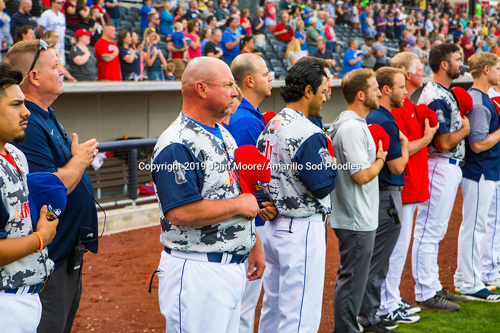 Amarillo Sod Poodles Manager Phillip Wellman stands during the National Anthem before the game against the Frisco Rough Riders on Monday, June 3, 2019, at HODGETOWN in Amarillo, Texas. [Photo by John Moore/Amarillo Sod Poodles]