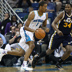 April 11, 2011; New Orleans, LA, USA; New Orleans Hornets small forward Trevor Ariza (1) drives past Utah Jazz small forward C.J. Miles (34) during the first half at the New Orleans Arena.  Mandatory Credit: Derick E. Hingle