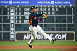 March 26, 2018 - Houston, TX, U.S. - HOUSTON, TX - MARCH 26: Houston Astros infielder Alex Bregman (2) makes a play at first during the game between the Milwaukee Brewers and Houston Astros at Minute Maid Park on March 26, 2018 in Houston, Texas. (Photo by Ken Murray/Icon Sportswire) (Credit Image: © Ken Murray/Icon SMI via ZUMA Press)