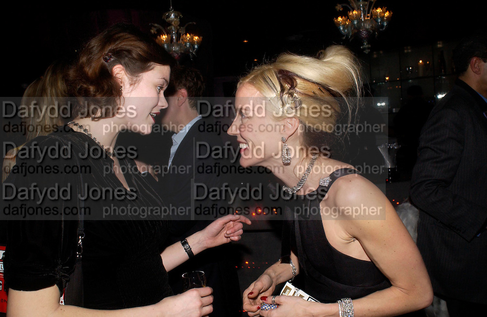 Jasmine Guinness and Daphne Guinness, party given by Daphne Guinness for Christian Louboutin  after the opening of his new shopt.  Baglione Hotel. 16 March 2004.  ONE TIME USE ONLY - DO NOT ARCHIVE  © Copyright Photograph by Dafydd Jones 66 Stockwell Park Rd. London SW9 0DA Tel 020 7733 0108 www.dafjones.com