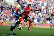 Cardiff city's Fraizer Campbell battles for the ball with Everton's Sylvain Distin.  Barclays Premier league, Cardiff city v Everton at the Cardiff city Stadium in Cardiff,  South Wales on Saturday 31st August 2013. pic by Andrew Orchard,  Andrew Orchard sports photography,