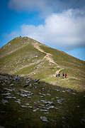 People making their way up Catstye Cam summit, west of Helvellyn mountain, The Lake District, Cumbria, United Kingdom on the 2nd of August 2021. Catstye Cam is connected to Helvellyn by Swirral Edge, one of the famous walking routes in the Lake District. (photo by Andrew Aitchison / In pictures via Getty Images)
