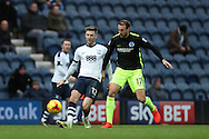 Preston North End midfielder Paul Gallagher (12) and Brighton & Hove Albion centre forward Glenn Murray (17) during the EFL Sky Bet Championship match between Preston North End and Brighton and Hove Albion at Deepdale, Preston, England on 14 January 2017.