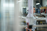 SEPTEMBER 13, 2016: A hispanic production line worker prepares a machine for manufacturing on the plant floor.