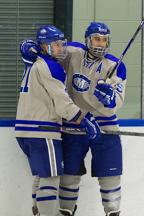 Brendan Cosgrove and Ben Chwick, of Colby College, in a NCAA Division III hockey game against the University of Southern Maine on November 19, 2013 in Waterville, ME. (Dustin Satloff/Colby College Athletics)