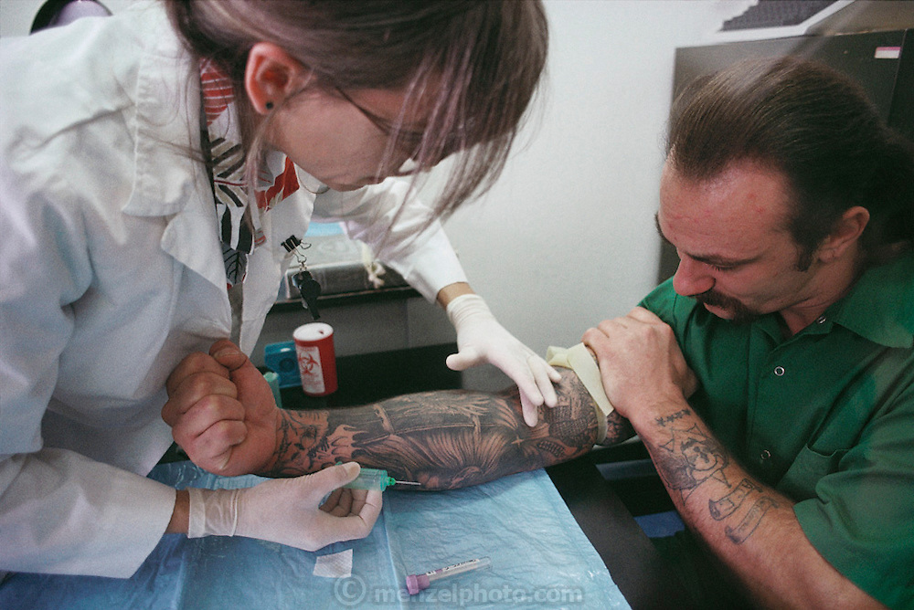 (1992) At the California Department of Corrections medical facility, in Vacaville California, prisoners entering in the system have their blood drawn for DNA records. DNA Fingerprinting.