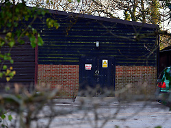 © Licensed to London News Pictures. 20/02/2013. Blackmoor, UK. A storage building on Lord Selborne's Blackmoor Estate. Two farm workers have died in a fruit packhouse on a Tory peer's country estate in Hampshire. The two men, Scott Cain, 23, and Ashley Clarke, 24, were found unconscious on Monday afternoon in the apple store at the Blackmoor Estate in Blackmoor, near Liss, which is owned by Lord Selborne..Members of staff as well as the emergency services attempted to resuscitate the two men but were unsuccessful. A spokeswoman for North Hampshire Coroner Andrew Bradley said that the store room used nitrogen to cool the fruit but a cause of death was not yet known.. Photo credit : Stephen Simpson/LNP