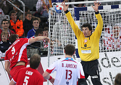 Lars Christiansen of Denmark  vs Goalkeeper of Poland Slawomir Szmal during 21st Men's World Handball Championship 2009 Bronze medal match between National teams of Poland and Denmark, on February 1, 2009, in Arena Zagreb, Zagreb, Croatia.  (Photo by Vid Ponikvar / Sportida)