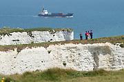 Walkers near Old Harry Rocks. Isle of Purbeck, Dorset, UK.