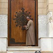 Khedive Tawfik Mausoleum's warden unlocks its grand doors. Qarafa, Cairo.