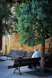 Old man sitting in the square in Adahuesca, Huesca, Aragon, Spain<br /> <br /> (c) Andrew Wilson   Edinburgh Elite media