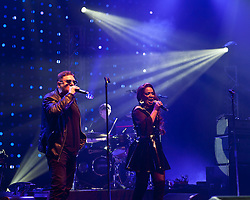 © Licensed to London News Pictures. 10/05/2012. London, UK.  Happy Mondays perform live at O2 Academy Brixton.  In picture L to R - Shaun Ryder (vocals), Gary Whelan (drums), Rowetta Satchell (vocals).  Photo credit : Richard Isaac/LNP