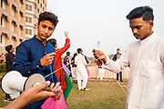 DELHI, INDIA – JANUARY 14, 2020: Children prepare homemade kites as part of the annual festival of Uttarayan. Observed each year in the lunar month of Magha (January), the festival commemorates the end of winter and the anticipation of a fruitful harvest season, and is celebrated by flying kites.