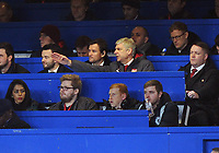 Football - 2017 / 2018 Carabao (EFL/League) Cup - Semi-Final, First Leg: Chelsea vs. Arsenal<br /> <br /> Arsenal Manager Arsene Wenger watches from the stands with German Jens Lehmann, at Stamford Bridge.<br /> <br /> COLORSPORT/ANDREW COWIE