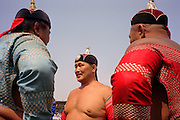 Ulaanbaatar, Mongolia, July 2003..Competitors in the Mongolian Wrestling championships in the national Naadam at Ulaanbaatar central stadium.