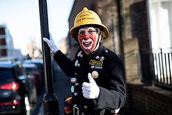 "© Licensed to London News Pictures. 03/02/2019. London, UK. Clowns attend the Grimaldi Church Service at All Saints Church in Haggerston. The service commemorates the ""father"" of the modern clown, Joseph Grimaldi. Photo credit : Tom Nicholson/LNP"