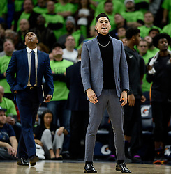 December 16, 2017 - Minneapolis, MN, USA - Injured Phoenix Suns guard Devin Booker steps out onto the court following a foul call against the Minnesota Timberwolves late in the fourth quarter on Saturday, Dec. 16, 2017, at Target Center in Minneapolis. The Suns won, 108-106. (Credit Image: © Aaron Lavinsky/TNS via ZUMA Wire)