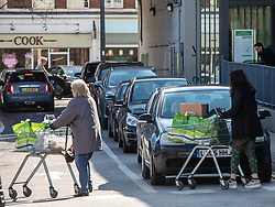 © Licensed to London News Pictures. 06/03/2020. London, UK. Shoppers stock up on household items at Waitrose. Queues of cars form at a Waitrose car park in South West London as increased buying continues to hit some of the big supermarkets after a second hospital patient is feared to have succumbed to the Coronavirus disease. Photo credit: Alex Lentati/LNP