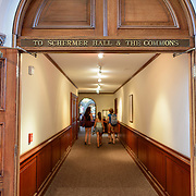 Smithsonian Castle Schermer Hall and Commons Corridor. Corridor leading to the Schermer Hall and the Commons inside the Smithsonian Castle. Formally known as the Smithsonian Institution Building, the Smithsonian Castle houses the administrative headquarters fo the Smithsonian Institution as well as some a permanent exhibition titled Smithsonian Institution: America's Treasure Chest. It's distinctive architectural style stands out on the southern side of the National Mall in Washington DC.