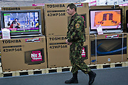 Moscow, Russia, 02/12/2006.&#xA;A security guard patrols the store during the first day of trading at the first Moscow branch of the German owned Media Markt electronics store. Media Markt is the largest consumer electronics retailer in Europe, and the store opened at 7.00 am to cope with anticipated demand.<br />