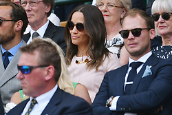© Licensed to London News Pictures. 08/07/2019. London, UK. Pippa Middleton watches centre court tennis from the Royal Box at the Wimbledon Tennis Championships 2019 on Day 7 held at the All England Lawn Tennis and Croquet Club. Photo credit: Ray Tang/LNP