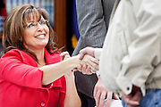"""Dec. 1, 2009 -- TEMPE, AZ: Former Alaska Governor SARAH PALIN signs copies of her book, """"Going Rogue"""" at a Costco in Tempe, AZ, Tuesday. More than one thousand people showed up for the signing. About 150 of them spent the night at the store. Palin did not make any comments or speak to the address during her appearance in Tempe.  Photo by Jack Kurtz"""