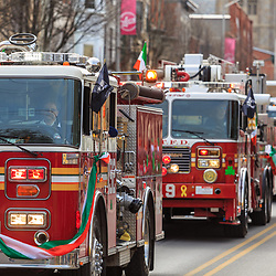 York, PA - March 12, 2016: Fire engines with local firefighters at the annual Saint Patrick's Day Parade.