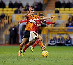 Wolverhampton Wanderers' Kevin McDonald challenges for the ball with  Bristol City's Bobby Reid - Photo mandatory by-line: Dougie Allward/JMP - Tel: Mobile: 07966 386802 25/01/2014 - SPORT - FOOTBALL - Molineux Stadium - Wolverhampton - Wolverhampton Wanderers v Bristol City - Sky Bet League One