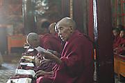 India, Ladakh region state of Jammu and Kashmir, Spituk monastery. Priests at prayer