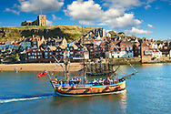 Tourists on a Pirate boat  in Whitby harbour. North Yorkshire, England .<br /> <br /> Visit our ENGLAND PHOTO COLLECTIONS for more photos to download or buy as wall art prints https://funkystock.photoshelter.com/gallery-collection/Pictures-Images-of-England-Photos-of-English-Historic-Landmark-Sites/C0000SnAAiGINuEQ
