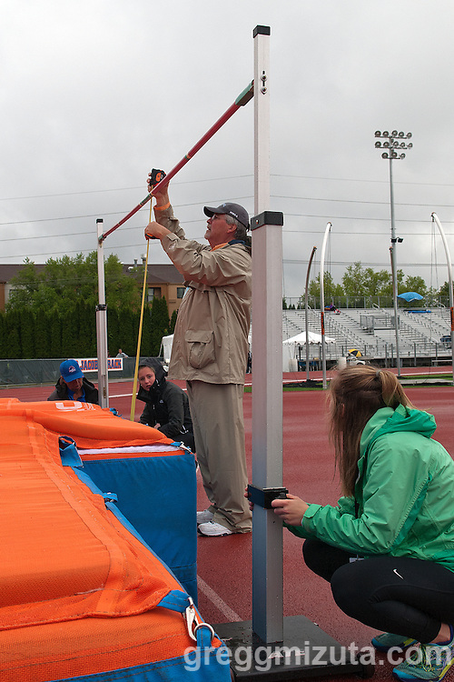Meet official Gary Gorrell checks the height of the high jump bar during the Idaho High School Track & Field State Championships at Dona Larson Park, Boise, Idaho. May 15, 2015. Gorrell was the head coach of 11 boys and 3 girls state championship teams while coaching at Meridian, Centennial, and Eagle.