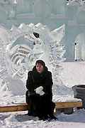 Khabarovsk, Russia, 01/03/2004.&#xD;People walk among among ice statues in city centre at lunch-time.&#xD;&#xD;<br />