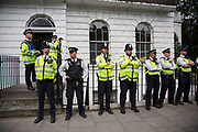 Class War march arrives at Boris Johnson's house in Islington which is being guarded by a line of police on 15th July in London, United Kingdom. The anarchist group organised this event weeks ago well before Boris Johnson became Foreign Secretary, which has only inflamed the anger amongst protesters at the class and wealth divide between rich and poor and the gentrification of London.