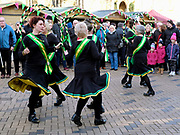 Persephone Womens Morris dancing side performing at the Wakefield Rhubarb festival in Yorkshire, UK on 24th February 2018. Persephone are a North West old Lancashire and Cheshire areas of England Processional Morris side wearing a distinctive black kit with accents of green and yellow